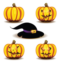 halloween pumpkins and hat vector image