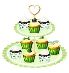 Green cupcakes with a stand vector