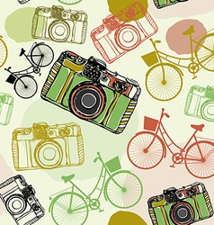 Vintage film camera and bicycles seamless pattern vector