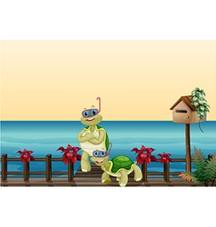 Two turtles beside a wooden mailbox vector