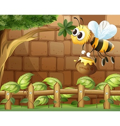 A bee holding a honey inside the fence vector