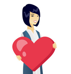 Young asian business woman holding a big heart vector
