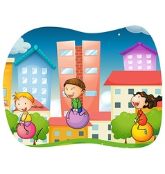 Boy and girls bouncing on the ball in the park vector