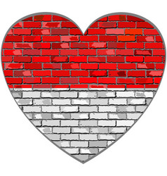 flag of indonesia on a brick wall in heart shape vector image vector image