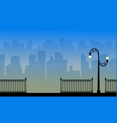Landscape silhouette of city with street lamp vector