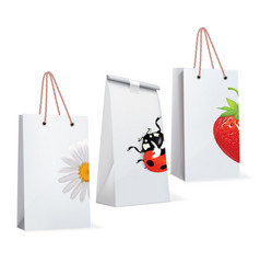 Paper bags with adybird strawberry chamomile vector