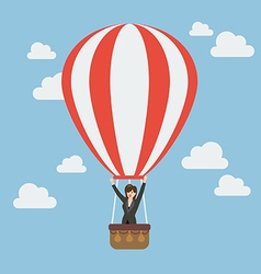 Business woman celebrating in hot air balloon vector