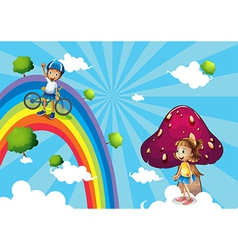 A boy biking in the rainbows vector