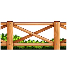 A wooden fence design with plants at the back vector