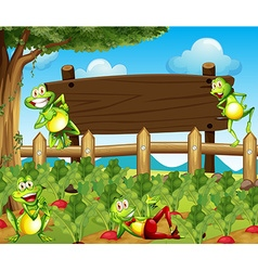 Frogs and wooden sign in the farm vector image vector image