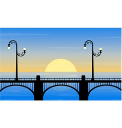 silhouette of bridge with street lamp at sunset vector image