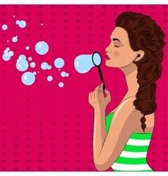 Pretty pop art girl blowes soap bubbles vector image