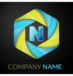 N letter colorful logo in the hexagonal on black vector