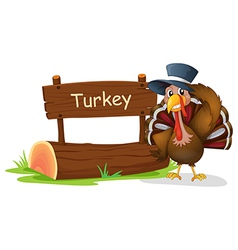 A turkey with a hat beside a signboard vector image