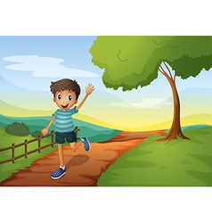 A young boy waving his hand while running vector image