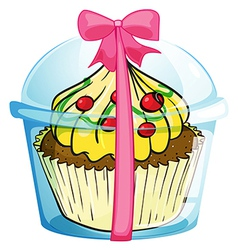 A cupcake with a pink ribbon vector image vector image