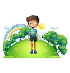 A boy standing in the middle of the hill vector image