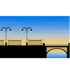Silhouette of bridge on sea with street lamp vector