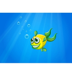 A smiling yellow fish underwater vector