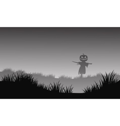Silhouette of halloween scarecrow in fields vector