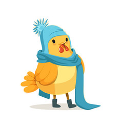 Funny chick wearing a blue knitted hat and scarf vector