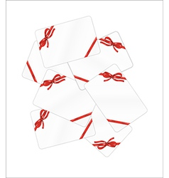 Mess of white gift cards with red ribbon and bow vector