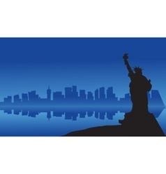 Silhouette of statue liberty from sea vector image
