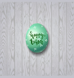 Colorful easter egg on white wooden background vector