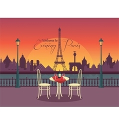 View of evening paris from the cafe vector image