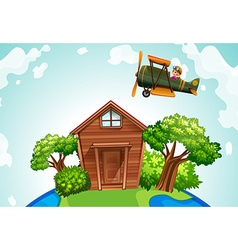 Airplane flying over a wooden house vector