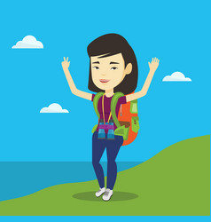 Backpacker with her hands up enjoying the scenery vector