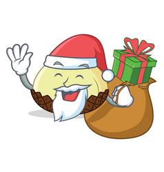 Santa with gift snake fruit mascot cartoon vector