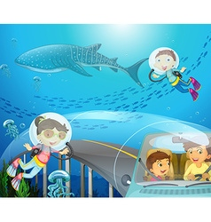 Boy and girl scuba diving under the ocean vector