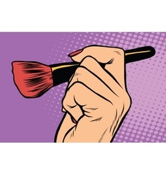Make-up brush in hand vector