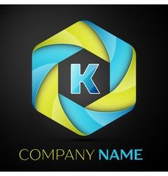 K letter colorful logo in the hexagonal on black vector