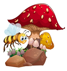 A bee near the giant red mushroom vector