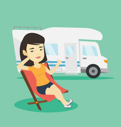 Woman sitting in chair in front of camper van vector