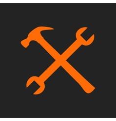 Crossed orange tools on black vector