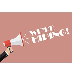 Hand holding megaphone with word we are hiring vector