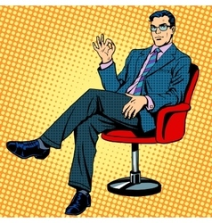Businessman sitting in an armchair gesture okay vector