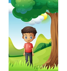 A boy under the shade of a big tree vector