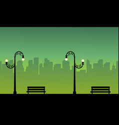 Silhouette of town with street lamp style vector