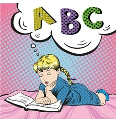 Little girl reading book on a bed vector