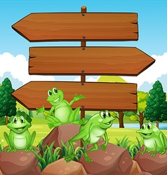 Sign template with frogs on rocks vector image vector image