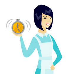 Young asian cleaner holding alarm clock vector
