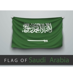 Flag of saudi arabia battered hung on the wall vector