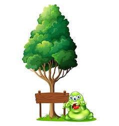 A monster and a signboard under the tree vector image vector image