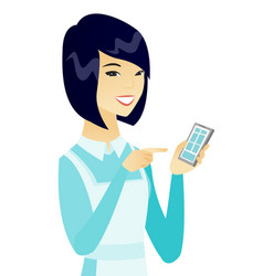Young asian cleaner holding a mobile phone vector