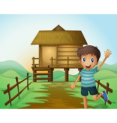 A boy waving his hand in front of a nipa hut vector