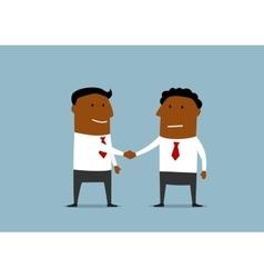 Two happy businessmen shaking hands vector image